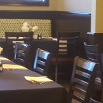 Interior of The Langton's private dining room at Matt the Miller's Carmel location with flowers and place settings on tables.