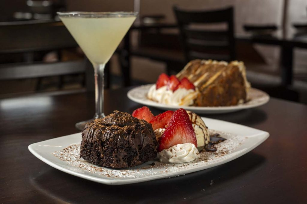 Carrot Cake and Lava Cake desserts together with lemon martini cocktail