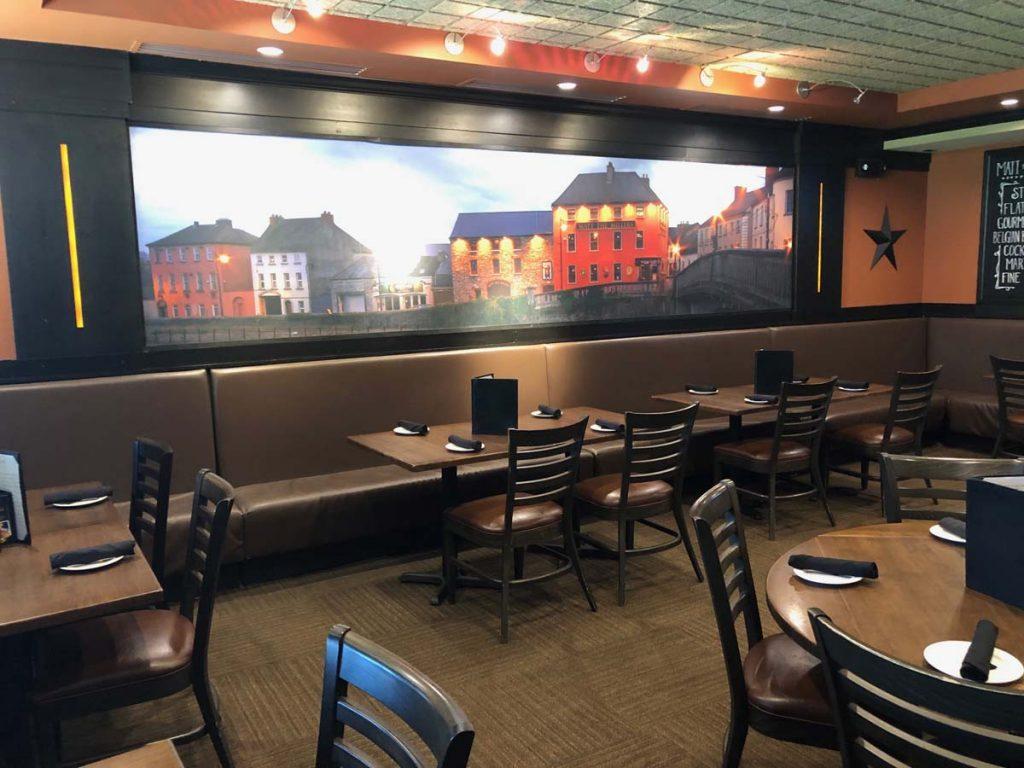 Mural on wall showing Irish pubs in dining room at Matt the Miller's Tavern Dublin, Ohio location