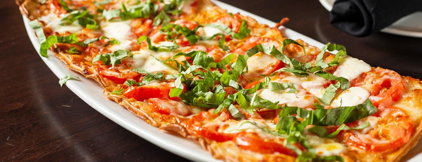 Flatbread pizza with basil garnish